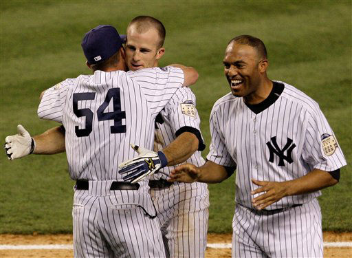 New York Yankees hitting coach Kevin Long &#40;54&#41; and Mariano Rivera, right, congratulate Brett Gardner after he hit the game-winning RBI single off Boston Red Sox&#39;s Jonathan Papelbon in the 10th inning of a baseball game at Yankee Stadium in New York, Sunday, July 6, 2008. The Yankees won 5-4. &#40;AP Photo&#47;Kathy Willens&#41; <span class=meta>(AP Photo&#47; Kathy Willens)</span>