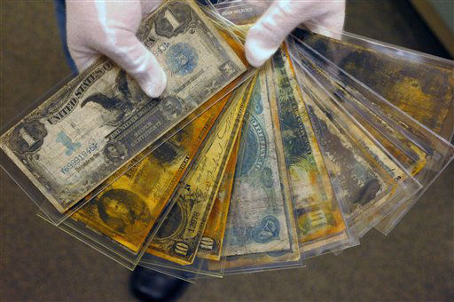"<div class=""meta ""><span class=""caption-text "">FILE - In this Friday, Aug 15, 2008 file photo, currency, part of the artifacts collection of the Titanic, is shown at a warehouse in Atlanta. The owner of the largest trove of artifacts salvaged from the Titanic is putting the vast collection up for auction scheduled for April 1 by Guernsey's, a New York City auction house. (AP Photo/Stanley Leary, File) (AP Photo/ STANLEY LEARY)</span></div>"
