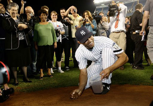 "<div class=""meta ""><span class=""caption-text "">His mother Naomi, far left, and other family members watch as New York Yankees closer Mariano Rivera gathers dirt from the pitcher's mound after the the Yankees beat the Baltimore Orioles 7-3 on Sunday, Sept. 21, 2008, in what is likely the final baseball game at Yankee Stadium in New York. (AP Photo/Kathy Willens) (AP Photo/ Kathy Willens)</span></div>"