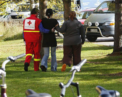 Red Cross workers take away a shocked student at the Kauhajoki School of Hospitality, in Kauhajoki, western Finland, on Tuesday Sept. 23, 2008. A masked gunman whose violent YouTube postings prompted police to question him just a day earlier opened fire Tuesday at his trade school in western Finland, killing 10 people and burning some of their bodies before shooting himself in the head. &#40;AP Photo &#47; Gunnar B?ckman, LEHTIKUVA&#41;  ** FINLAND OUT NO SALES ** <span class=meta>(AP Photo&#47; Gunnar B?ckman)</span>