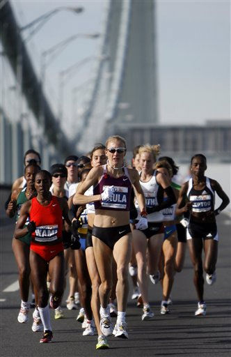 FILE - In this Nov. 2, 2009, file photo, Paula Radcliffe leads the women&#39;s elite runners across the Verrazano Narrows Bridge at the start of the ING New York City Marathon in New York. Radcliffe will defend her title at the New York City Marathon. The New York Road Runners announced Thursday, OCt. 1, 2009, that Radcliffe will attempt to win her fourth NYC Marathon title overall.   &#40;AP Photo&#47;Jason DeCrow, File&#41; <span class=meta>(AP Photo&#47; Jason DeCrow)</span>
