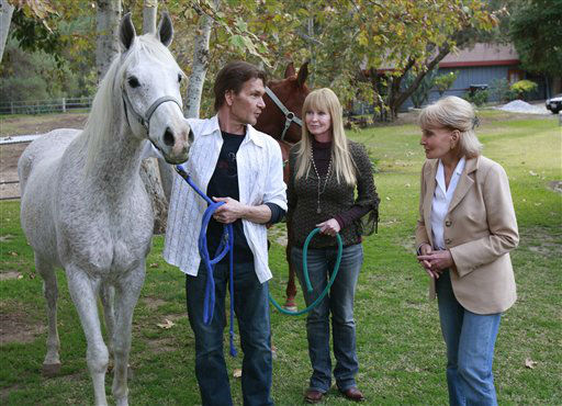 In this image released by ABC, Barbara Walters, right, visits with actor Patrick Swayze, left, and his wife Lisa Niemi at their California ranch on Dec. 6, 2008.  In his first television interview since being diagnosed with pancreatic cancer, Swayze speaks to Barbara Walters in  &#34;Barbara Walters Special-Patrick Swayze: The Truth&#34;, airing Wednesday, Jan. 7, 2009, at 10:00 p.m. EDT.   &#40;AP Photo&#47;ABC, Ron Tom&#41; ** NO SALES ** <span class=meta>(AP Photo&#47; RON TOM)</span>