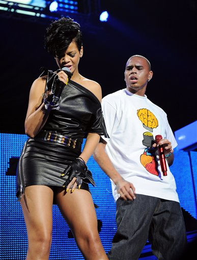 ** FILE ** In a Dec. 12, 2008 file photo singers Rihanna and Chris Brown perform at Madison Square Garden in New York.  Brown, who was arrested a week ago in connection with a domestic violence investigation, said Sunday Feb. 15, 2009 he is &#34;sorry and saddened&#34; by what happened and is seeking counseling from his pastor and loved ones. &#40;AP Photo&#47;Evan Agostini&#41; <span class=meta>(AP Photo&#47; Evan Agostini)</span>