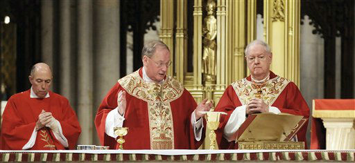 "<div class=""meta image-caption""><div class=""origin-logo origin-image ""><span></span></div><span class=""caption-text"">** RETRANSMISSION OF NYRD103 FOR ALTERNATE CROP ** Milwaukee Archbishop Timothy M. Dolan, center, celebrates Mass with New York's Cardinal Edward Egan at St. Patrick's Cathedral, in New York Monday, Feb. 23, 2009. Dolan, defender of Roman Catholic orthodoxy who led an elite seminary for U.S. priests and became known for his energy, wit and warmth, was named archbishop of New York on Monday. (AP Photo/Richard Drew) (AP Photo/ Richard Drew)</span></div>"
