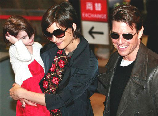 Actor Tom Cruise, right, and actress Katie Holmes with their daughter Suri arrive at Narita International Airport in Narita, east of Tokyo, Sunday, March 8, 2009. Cruise is here for the premiere of his new film &#34;Valkyrie.&#34; &#40;AP Photo&#47;Itsuo Inouye&#41; <span class=meta>(AP Photo&#47; Itsuo Inouye)</span>