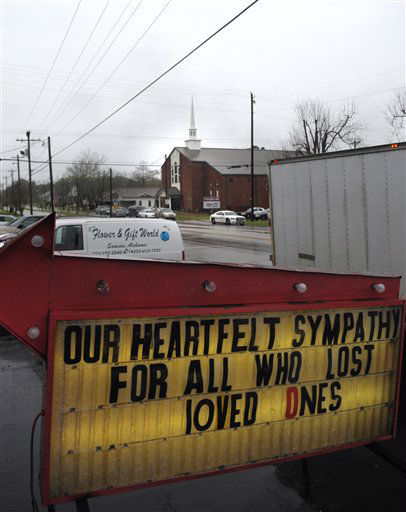 A sign in front of Flower and Gift World remembers those that lost their lives during last week&#39;s shooting rampage by gunman suspect Michael McLendon while funeral services for his mother Lisa McLendon are being held at Samson Baptist Church, seen in the background. &#40;AP Photo&#47;The Dothan Eagle, Jay Hare&#41; <span class=meta>(AP Photo&#47; Jay Hare)</span>