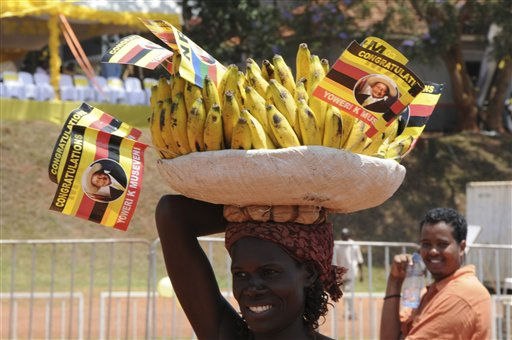 A banana seller display flags with the portrait of Ugandan President Yoweri Museveni&#39;s at a rally to celebrate the Presidential victory at Kololo Airstrip, Uganda, Friday, Feb 25 2011. Museveni won the elections to rule Uganda for another term of 5 years. Museveni has been in power in Uganda for 25 years, despite pledges earlier in his career to not follow in the footsteps of long-serving African dictators. &#40;AP Photo&#47; Ronald Kabuubi&#41; <span class=meta>(AP Photo&#47; Ronald Kabuubi)</span>