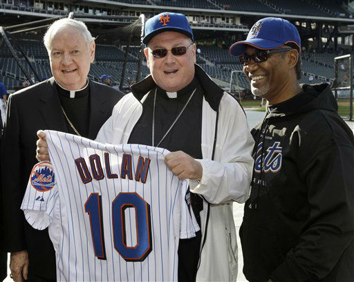 FILE - In this file photo of Friday, April 17, 2009, Archbishop Timothy Dolan poses for photographs with Archbishop Emeritus of New York, Cardinal Edward Egan, left, and New York Mets manager Jerry Manuel, right, before a baseball game between the New York Mets and the Milwaukee Brewers in New York. Archbishop Dolan has been basking in the attention of the nation&#39;s largest media stage as tries to reach the masses in his new position as the Roman Catholic leader of New York. &#40;AP Photo&#47;Frank Franklin II, File&#41; <span class=meta>(AP Photo&#47; Frank Franklin II)</span>