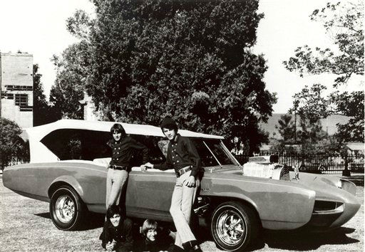 FILE - In this 1966 file photo, cast members of the television show &#34;The Monkees,&#34; from top left, Davy Jones, Michael Nesmith, from lower left, Micky Dolenz, and Peter Tork pose next to their customized Pontiac GTO. General Motors announced this past week that it is killing off the Pontiac brand.  &#40;AP Photo&#47;File&#41; <span class=meta>(AP Photo&#47; Anonymous)</span>