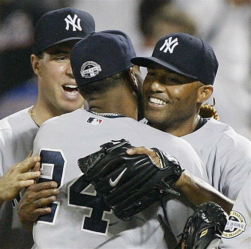 New York Yankees first baseman Mark Teixeira, left, looks on as second baseman Robinson Cano embraces closer Mariano Rivera after Rivera closed out his 500th save in the Yankees 4-2 victory over the New York Mets in their interleague baseball game at Citi Field in New York, Sunday, June 28, 2009.  &#40;AP Photo&#47;Kathy Willens&#41; <span class=meta>(AP Photo&#47; Kathy Willens)</span>