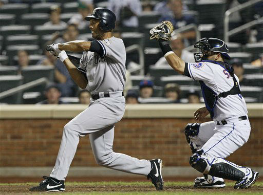 "<div class=""meta ""><span class=""caption-text "">In this photo taken Sunday, June 28, 2009, New York Yankees closer Mariano Rivera, left, holds his swing as New York Mets catcher Omir Santos catches ball four from New York Mets closer Francisco Rodriguez in the ninth inning of their interleague baseball game at Citi Field in New York.  Rivera drew a bases loaded walk on the play for his first career RBI.  (AP Photo/Kathy Willens) (AP Photo/ Kathy Willens)</span></div>"