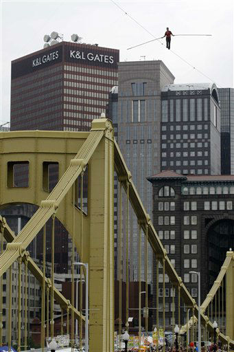 Nik Wallenda walks a 1000 foot-long high-wire, suspended 200 feet over the Allegheny River in downtown Pittsburgh Friday, July 3, 2009. &#40;AP Photo&#47;Gene J. Puskar&#41; <span class=meta>(AP Photo&#47; Gene J. Puskar)</span>