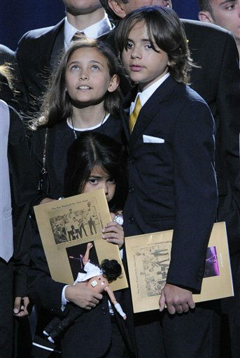 Paris Jackson, left, Prince Michael Jackson I and Prince Michael Jackson II on stage during the memorial service for Michael Jackson at the Staples Center in Los Angeles, Tuesday, July 7, 2009. &#40;AP Photo&#47;Mark J. Terrill, Pool&#41; <span class=meta>(AP Photo&#47; Mark J. Terrill)</span>
