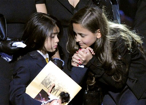 Michael Jackson daughter Paris Jackson, right, holds the hand of Prince Michael Jackson II during the memorial service for Michael Jackson at the Staples Center in Los Angeles, Tuesday, July 7, 2009. &#40;AP Photo&#47;Mark J. Terrill, Pool&#41; <span class=meta>(AP Photo&#47; Mark J. Terrill)</span>