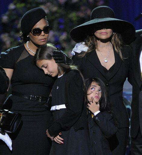 ** FOR USE AS DESIRED, YEAR END PHOTOS ** FILE - Singer Janet Jackson, left, Paris Katherine Jackson, Prince Michael Jackson II, and LaToya Jackson are seen on stage during the memorial service for Michael Jackson at the Staples Center in Los Angeles, in this July 7, 2009 file photo. &#40;AP Photo&#47;Mark J. Terrill, Pool, File&#41; <span class=meta>(AP Photo&#47; Mark J. Terrill)</span>