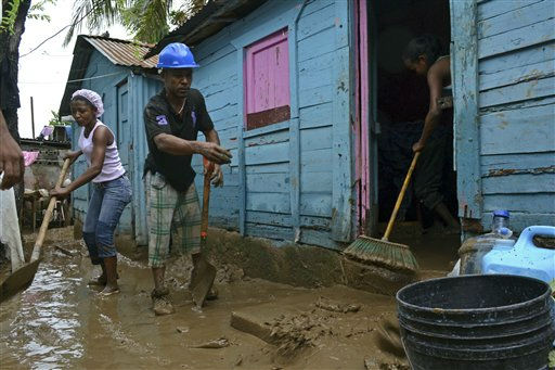 Residents sweep the mud off their house in San Cristobal, Dominican Republic after it was flooded by an overflowed river due to the passing of Hurricane Irene on Wednesday, Aug. 24, 2010. Flooding, rising rivers and mudslides have prompted the Dominican Republic government to evacuate nearly 38,000 people and more slides were likely in coming days because of days of intense rain from the storm system. &#40;AP Photo&#47;Roberto Guzman&#41; <span class=meta>(AP Photo&#47; Roberto Guzman)</span>