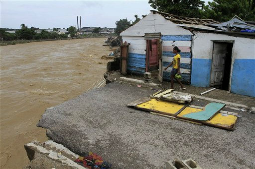 "<div class=""meta ""><span class=""caption-text "">A woman walks around houses damaged by an overflowed river in San Cristobal, Dominican Republic due to the passing of Hurricane Irene on Wednesday, Aug. 24, 2010. Flooding, rising rivers and mudslides have prompted the Dominican Republic government to evacuate nearly 38,000 people and more slides were likely in coming days because of days of intense rain from the storm system. (AP Photo/Roberto Guzman) (AP Photo/ Roberto Guzman)</span></div>"