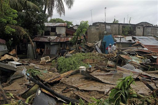 "<div class=""meta image-caption""><div class=""origin-logo origin-image ""><span></span></div><span class=""caption-text"">Residents search for their belongings in their damaged houses in San Cristobal, Dominican Republic after they were flooded by an overflowed river due to the passing of Hurricane Irene on Wednesday, Aug. 24, 2010. Flooding, rising rivers and mudslides have prompted the Dominican Republic government to evacuate nearly 38,000 people and more slides were likely in coming days because of days of intense rain from the storm system. (AP Photo/Roberto Guzman) (AP Photo/ Roberto Guzman)</span></div>"