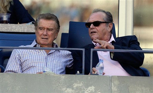 Actor Jack Nicholson, right, chats with Regis Philbin during the men's finals championship at the U.S. Open tennis tournament in New York, Monday, Sept. 14, 2009. (AP Photo/Charles Krupa)