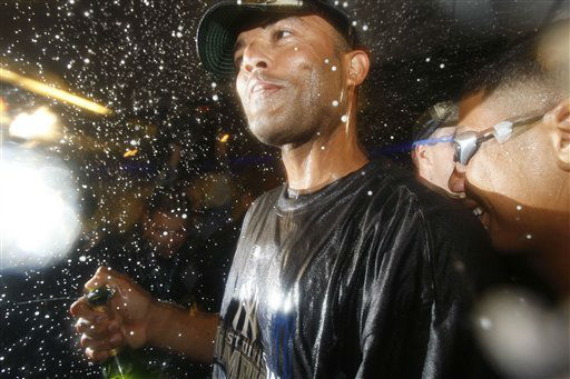 New York Yankees closer Mariano Rivera holds a bottle of champagne while celebrating the Yankees clinching the American League East Division title with the best record in baseball after beating the Boston Red Sox 4-2 in their baseball game at Yankee Stadium Sunday, Sept. 27, 2009 in New York. &#40;AP Photo&#47;Kathy Willens&#41; <span class=meta>(AP Photo&#47; Kathy Willens)</span>