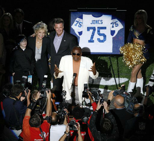 "<div class=""meta image-caption""><div class=""origin-logo origin-image ""><span></span></div><span class=""caption-text"">Former Los Angeles Rams defensive end Deacon Jones speaks during a ceremony as his jersey number is retired before the NFL football game between the St. Louis Rams and the Green Bay Packers on Sunday, Sept. 27, 2009, in St. Louis. (AP Photo/Tom Gannam) (AP Photo/ Tom Gannam)</span></div>"
