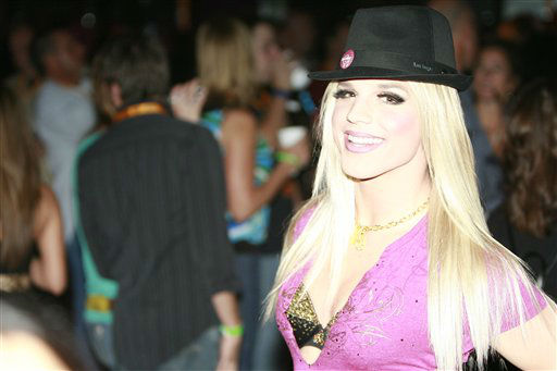 A Britney Spears impersonator attends the Hard Rock Cafe Las Vegas Grand Opening on Thursday, Oct. 15, 2009. &#40;Steven Bell &#47; AP Images for Hard Rock&#41; <span class=meta>(Photo&#47;Steven Bell)</span>