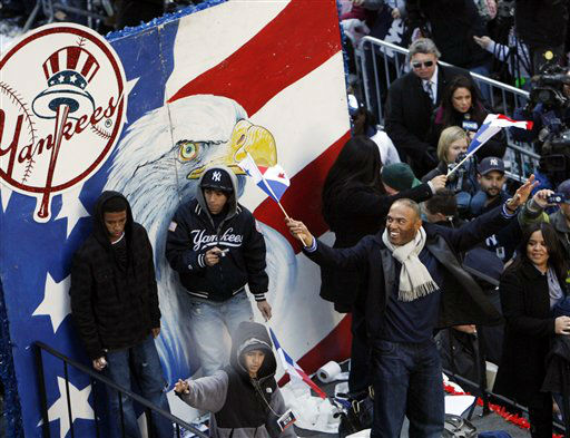 New York Yankees baseball player  Mariano Rivera, right, waves during a ticker-tape parade along Broadway celebrating their 27th World Series championship on Friday, Nov. 6, 2009,  in New York.   &#40;AP Photo&#47;Jason DeCrow&#41; <span class=meta>(AP Photo&#47; Jason DeCrow)</span>