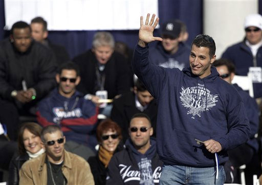 "<div class=""meta ""><span class=""caption-text "">New York Yankees' Andy Pettitte waves to fans after receiving a key to the city that was presented to him during a ceremony at City Hall celebrating the Yankees 27th World Series championship on Friday, Nov. 6, 2009, in New York.  (AP Photo/Julie Jacobson) (AP Photo/ Julie Jacobson)</span></div>"
