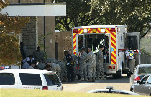"<div class=""meta image-caption""><div class=""origin-logo origin-image ""><span></span></div><span class=""caption-text"">In this image released by the U.S. Army, wounded are prepared for transport in waiting ambulances outside Fort Hood's Soldier Readiness Processing Center Thursday, Nov. 5, 2009, in Fort Hood, Texas. Army psychiatrist Maj. Nidal Malik Hasan is accused of firing more than 100 rounds Thursday, killing 13 and wounding others, in the soldier processing center at Fort Hood.  (AP Photo/U.S. Army, Jeramie Sivley) (AP Photo/ Jeramie Sivley)</span></div>"