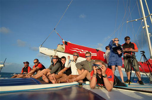 In this photo released by Tourism Queensland, people prepare to view a total solar eclipse while on a tour boat at Michelmas Cay on the Great Barrier Reef in Queensland state, Australia, Wednesday, Nov. 14, 2012. Starting just after dawn, the eclipse cast its 150-kilometer &#40;95-mile&#41; shadow in Australia&#39;s Northern Territory, crossed the northeast tip of the country and was swooping east across the South Pacific, where no islands are in its direct path. &#40;AP Photo&#47;Tourism Queensland, Ben Southall&#41; EDITORIAL USE ONLY <span class=meta>(AP Photo&#47; Ben Southall)</span>