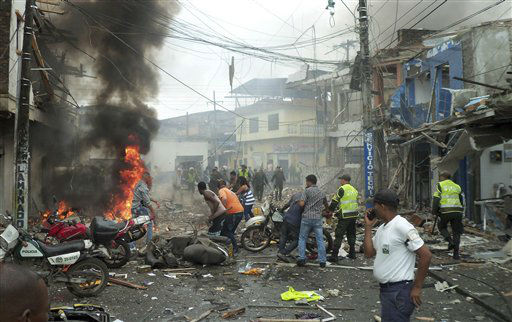 "<div class=""meta ""><span class=""caption-text "">Residents and police rush to the site where a bomb exploded outside a police station in Tumaco on Colombia's southern Pacific coast, Wednesday Feb. 1, 2012.  Police Gen. Rodolfo Palomino said that at least five people were killed and 20 wounded and blamed the leftist Revolutionary Armed Forces of Colombia, or FARC, for the attack. (AP Photo/Victor Manuel Correa, Diario del Sur) (AP Photo/ Victor Manuel Correa)</span></div>"