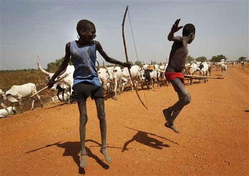 Young Sudanese cattle herdsmen jump at the sight of a foreign visitor outside Juba, Southern Sudan, Sunday Jan 9, 2011. About four million Southern Sudanese voters began casting their ballots Sunday in a weeklong referendum on independence that is expected to split Africa&#39;s largest nation in two.&#40;AP Photo&#47;Jerome Delay&#41; <span class=meta>(AP Photo&#47; Jerome Delay)</span>