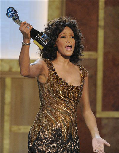 FILE - In this Saturday, Jan. 16, 2010 file photo, Whitney Houston accepts an award at the Warner Theatre during the 2010 BET Hip Hop Honors in Washington. Houston died Saturday, Feb. 11, 2012, she was 48. &#40;AP Photo&#47;Nick Wass&#41; <span class=meta>(AP Photo&#47; Nick Wass)</span>