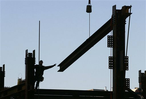An ironworker reaches for a beam suspended from a crane at One World Trade Center, Wednesday, Jan. 27, 2010 in New York. The tower, known as the Freedom Tower, will rise to a height of 1776 feet. &#40;AP Photo&#47;Mark Lennihan&#41; <span class=meta>(AP Photo&#47; Mark Lennihan)</span>