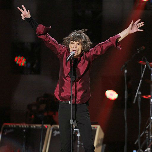 This image released by Starpix shows Mick Jagger of The Rolling Stones performing at the 12-12-12 The Concert for Sandy Relief at Madison Square Garden in New York on Wednesday, Dec. 12, 2012. Proceeds from the show will be distributed through the Robin Hood Foundation. &#40;AP Photo&#47;Starpix, Dave Allocca&#41; <span class=meta>(AP Photo&#47; Dave Allocca)</span>