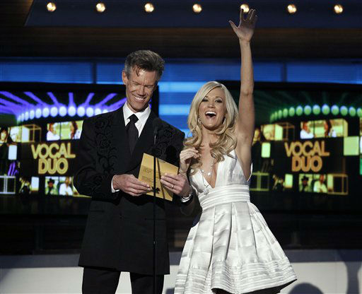 "<div class=""meta image-caption""><div class=""origin-logo origin-image ""><span></span></div><span class=""caption-text"">Randy Travis, left, and Carrie Underwood present the award for best vocal duo at the 45th Annual Academy of Country Music Awards in Las Vegas on Sunday, April 18, 2010.  (AP Photo/Matt Sayles) (AP Photo/ Matt Sayles)</span></div>"