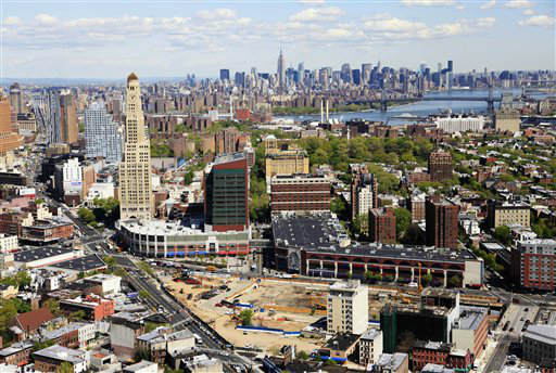 The proposed site for Atlantic Yards, foreground, is shown in this aerial photo of the Brooklyn borough of New York, Tuesday, April 20, 2010. The Manhattan skyline is in the distance. The Barclays Center, the future home of the New Jersey Nets, is to be part of the mixed use commercial and residential project. &#40;AP Photo&#47;Mark Lennihan&#41; <span class=meta>(AP Photo&#47; Mark Lennihan)</span>