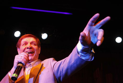 "<div class=""meta image-caption""><div class=""origin-logo origin-image ""><span></span></div><span class=""caption-text"">FILE - In this April 24, 2010 file photo, Russian singer Eduard Khil, known as ""Mr. Trololo"", performs during his concert in Moscow. Soviet crooner Khil , who gained international stardom in 2010 when his 1976 video of a vocalized song known as Trololo became a global Internet hit, died in St. Petersburg Sunday, June 3, 2012. (AP Photo/Sergey Ponomarev, File)</span></div>"