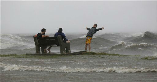 People play in the storm surge from Hurricane Isaac, on Lakeshore Drive along Lake Pontchartrain, as the storm nears land, in New Orleans, Tuesday, Aug. 28, 2012. &#40;AP Photo&#47;Gerald Herbert&#41; <span class=meta>(AP Photo&#47; Gerald Herbert)</span>