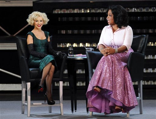 """<div class=""""meta image-caption""""><div class=""""origin-logo origin-image """"><span></span></div><span class=""""caption-text"""">Host Oprah Winfrey chats with singer Christina Aguilera, left, during """"The Oprah Winfrey Show"""" live from Radio City Music Hall, Friday, May 7, 2010 in New York. Ms. Winfrey was also celebrating the 10th anniversary of 'O' The Oprah Magazine.  (AP Photo/Evan Agostini) (AP Photo/ Evan Agostini)</span></div>"""