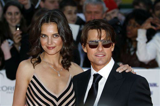 "<div class=""meta ""><span class=""caption-text "">U.S. actor Tom Cruise, right poses with his wife U.S. actress Katie Holmes, left, pose for the photographers as they arrive for the National Movie Awards at the Royal Festival Hall, in London, Wednesday, May 26, 2010. (AP Photo/Lefteris Pitarakis) (AP Photo/ Lefteris Pitarakis)</span></div>"