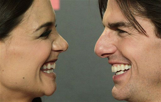 Actor Tom Cruise and his wife Katie Holmes pose during a photo-call for the world premiere of their new film &#34;Knight and Day&#34; at the Lope de Vega theatre in Seville, Spain on Wednesday June 16, 2010.  &#40;AP Photo&#47;Toni Rodriguez&#41; <span class=meta>(AP Photo&#47; Toni Rodriguez)</span>