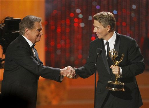 "<div class=""meta ""><span class=""caption-text "">Regis Philbin, left, presents Bradley P. Bell with the award for outstanding drama series for ""The Bold and the Beautiful"" at the 37th Annual Daytime Emmy Awards on Sunday, June 27, 2010, in Las Vegas. (AP Photo/Eric Jamison) (AP Photo/ Eric Jamison)</span></div>"