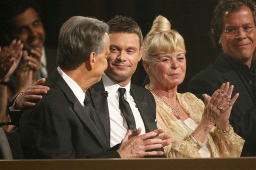 Dick Clark, left, looks at Ryan Seacrest  during the the American Bandstand Tribute at the 37th Annual Daytime Emmy Awards on Sunday, June 27, 2010, in Las Vegas. At right is Kari Clark.  &#40;AP Photo&#47;Eric Jamison&#41; <span class=meta>(AP Photo&#47; Eric Jamison)</span>