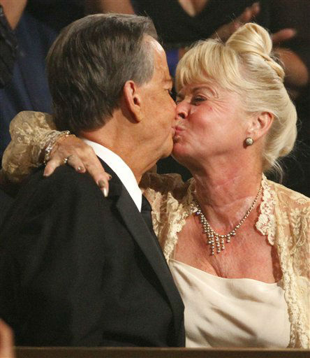"<div class=""meta ""><span class=""caption-text "">Dick Clark, left, kisses Kari Clark after  the American Bandstand Tribute at the 37th Annual Daytime Emmy Awards on Sunday, June 27, 2010, in Las Vegas.   (AP Photo/Eric Jamison) (AP Photo/ Eric Jamison)</span></div>"