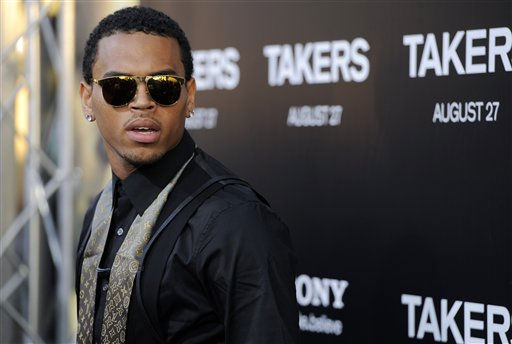 "<div class=""meta image-caption""><div class=""origin-logo origin-image ""><span></span></div><span class=""caption-text"">Chris Brown, a cast member in ""Takers,"" poses at the premiere of the film in Los Angeles, Wednesday, Aug. 4, 2010. (AP Photo/Chris Pizzello) (AP Photo/ Chris Pizzello)</span></div>"