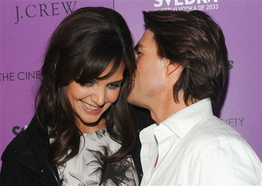 Actress Katie Holmes and husband actor Tom Cruise attend the premiere of 'The Romantics' hosted by The Cinema Society on Tuesday, Sept. 7, 2010 in New York. (AP Photo/Evan Agostini)