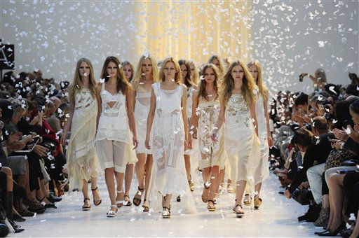 Models on parade among paper butterflies during the finale of the Antonio Marras Spring-Summer 2011 fashion collection, during the fashion week in Milan, Italy, Friday, Sept. 24, 2010. &#40;AP Photo&#47;Giuseppe Aresu&#41; <span class=meta>(AP Photo&#47; Giuseppe Aresu)</span>