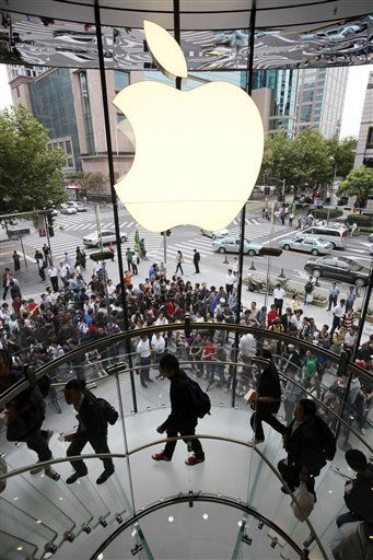 "<div class=""meta image-caption""><div class=""origin-logo origin-image ""><span></span></div><span class=""caption-text"">Customers line up for the Apple iPhone 4 at new Apple Store during the launch of the device Saturday, Sept. 25, 2010 in Shanghai. (AP Photo/Eugene Hoshiko) (AP Photo/ Eugene Hoshiko)</span></div>"