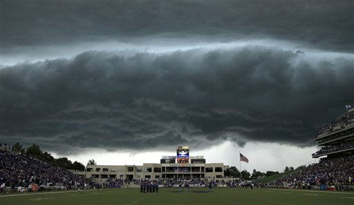 A thunderstorm approaches Bill Snyder Family Stadium during the first quarter of an NCAA college football game between Central Florida and Kansas State Saturday, Sept. 25, 2010 in Manhattan, Kan. Play was suspended in the game due to lightning. &#40;AP Photo&#47;Charlie Riedel&#41; <span class=meta>(AP Photo&#47; Charlie Riedel)</span>